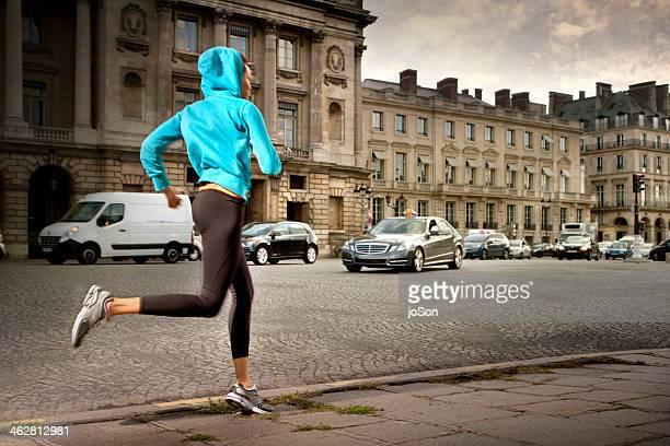 woman running at the Place de la Concord, Paris