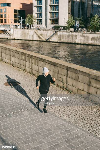 Woman running by the river.
