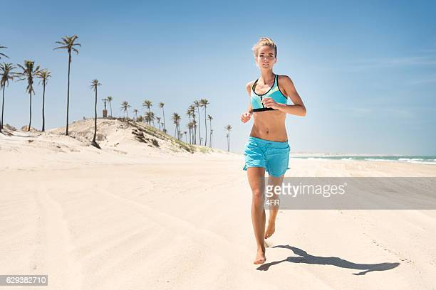 Woman running down the Beach