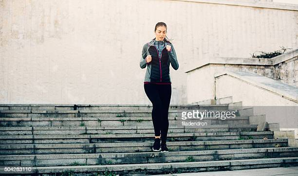 Woman Running Down The Stairs