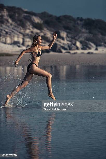 Woman running i shallow water