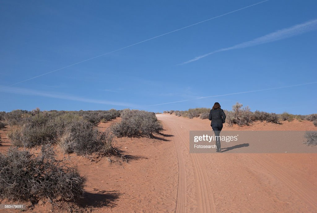 Woman running in a desert : Stock Photo
