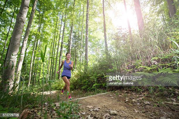 Woman running in a forest