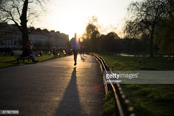 woman running in a park around london - jcbonassin stock pictures, royalty-free photos & images