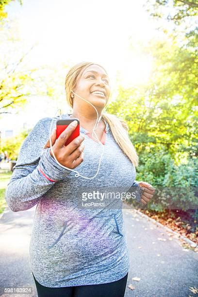 woman running in central park new york - big beautiful black women stock photos and pictures