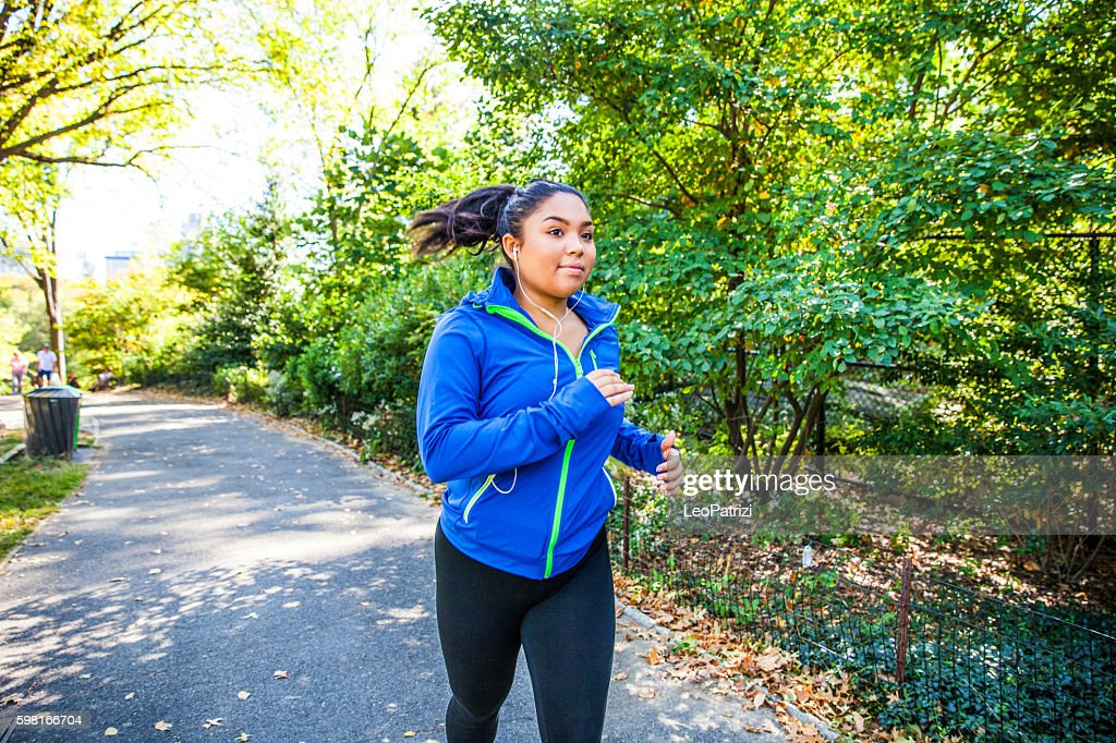 Woman running in Central Park New York : Stock Photo