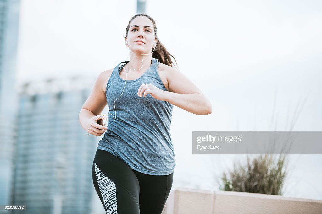 Woman Running in Downtown Austin : Stock Photo