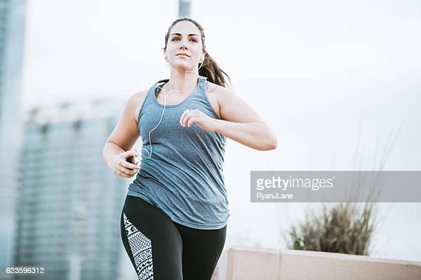 woman running in downtown austin - chubby stock photos and pictures