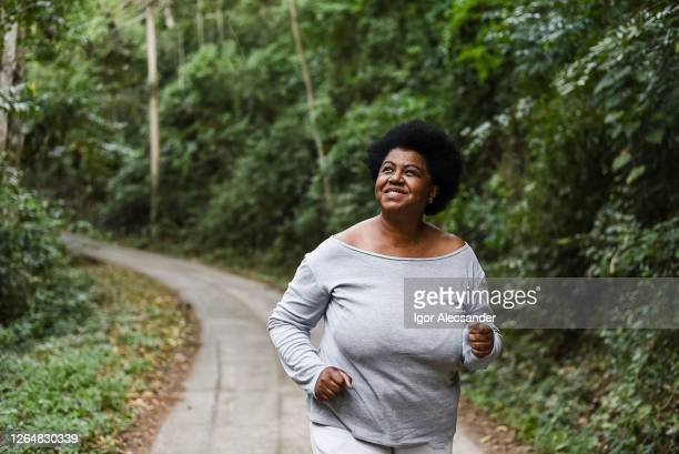 woman running in nature park - royal person stock pictures, royalty-free photos & images