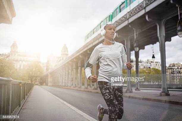 woman running in paris - afro caribbean ethnicity stock pictures, royalty-free photos & images