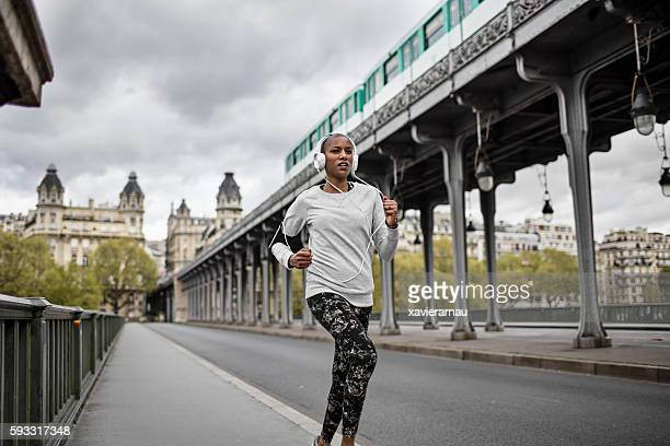 woman running in paris - mid adult women stock pictures, royalty-free photos & images