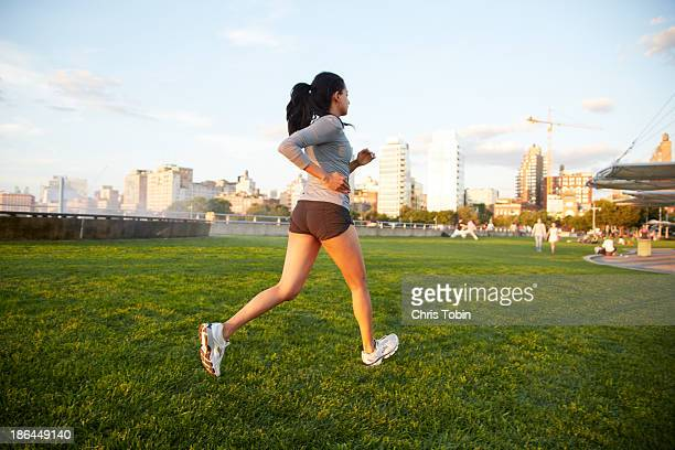Woman running in park in the city