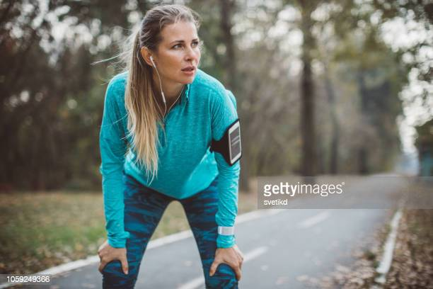 woman running in park - running stock pictures, royalty-free photos & images