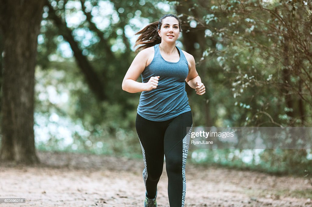 Woman Running in Park : Stock Photo
