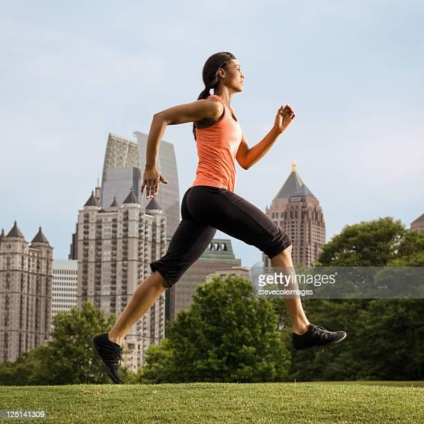 woman running in piedmont park, atlanta, georgia us - piedmont park atlanta georgia stock pictures, royalty-free photos & images