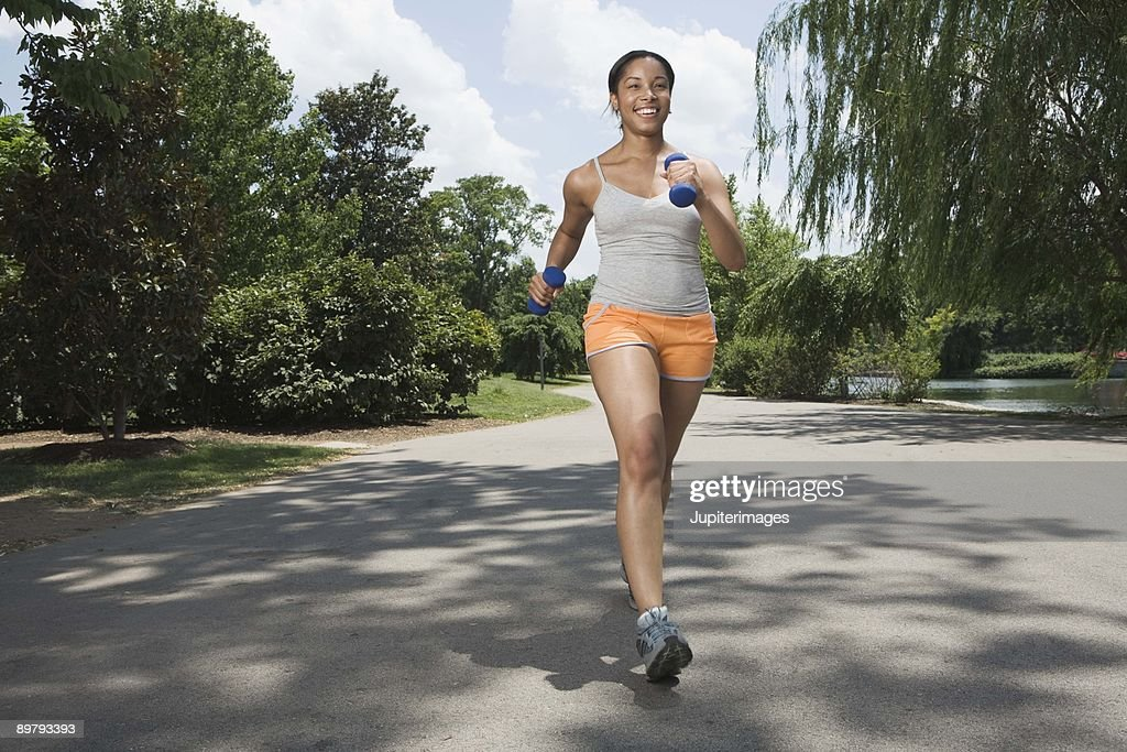 Woman running in street : Stock Photo