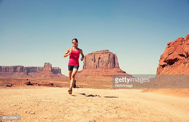 Woman Running in the Desert of Monument Valley