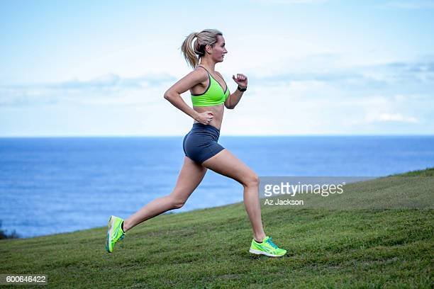 woman running in the park - sprinting stock photos and pictures