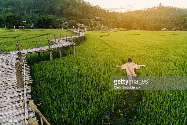 Woman running  in  the rice field