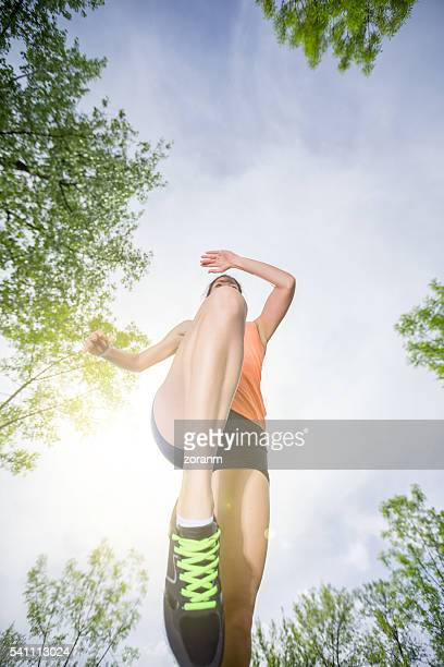 Woman running, low angle view