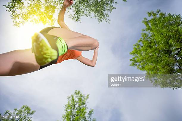 Woman running, mid-air