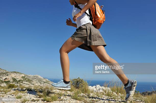 woman running on a hike in the calanques - cassis stock pictures, royalty-free photos & images