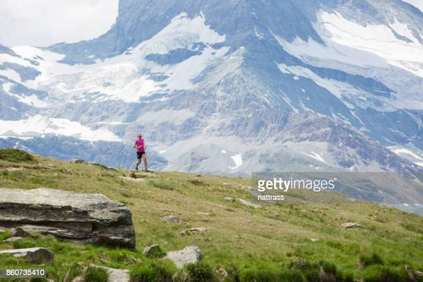 Woman running on a mountain trail