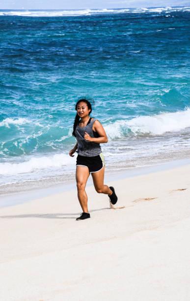 Woman Running On Beach, HaleIwa, United States