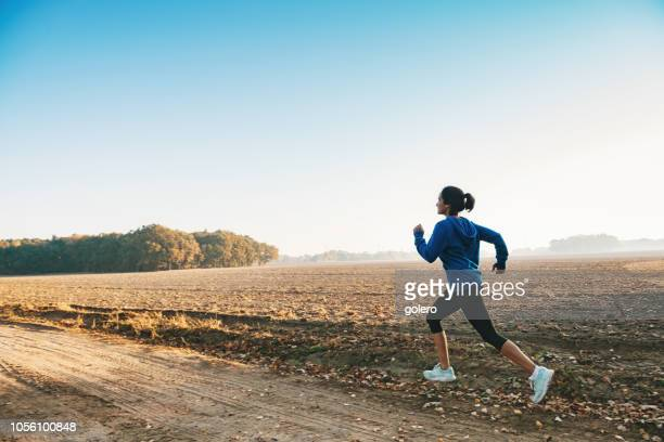 woman running on country path
