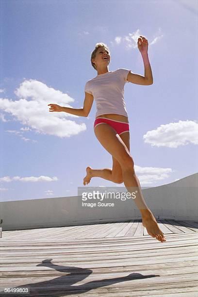 Woman running on decking