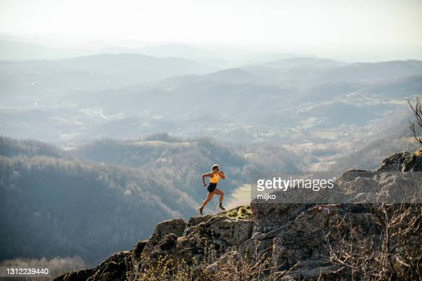 woman running on mountain - free images stock pictures, royalty-free photos & images