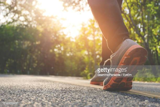 woman running on nature at autumn morning, healthy lifestyle concept. - 人の足 ストックフォトと画像