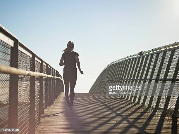 Woman running on skybridge