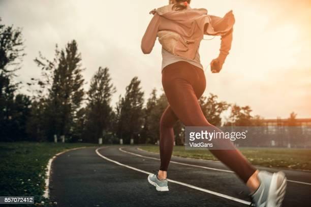 woman running on stadium track
