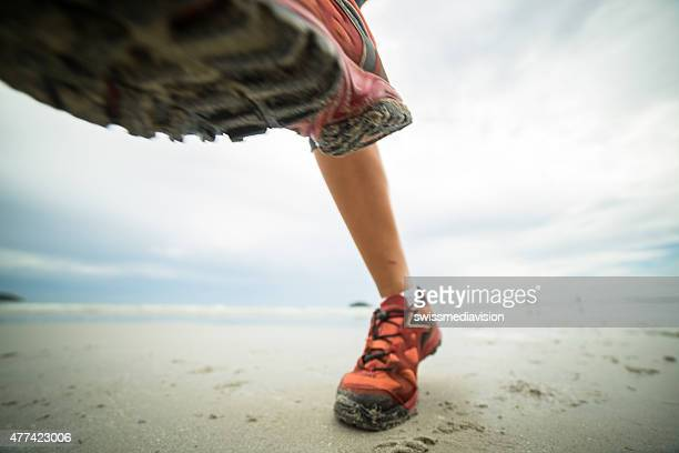 Woman running on the beach-Close up on shoes