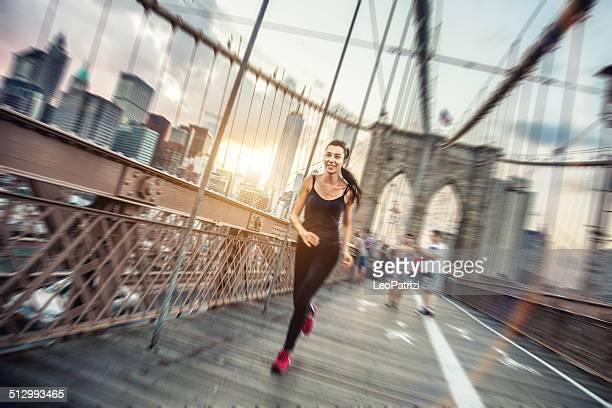 Woman running on the Brooklyn Bridge
