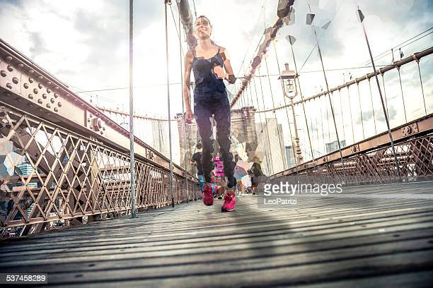 Woman running on the Brooklyn Bridge