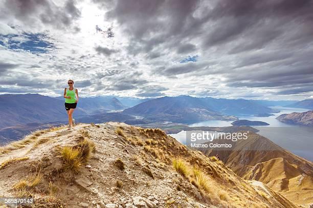 Woman running on the crest of mount Roy, Wanaka