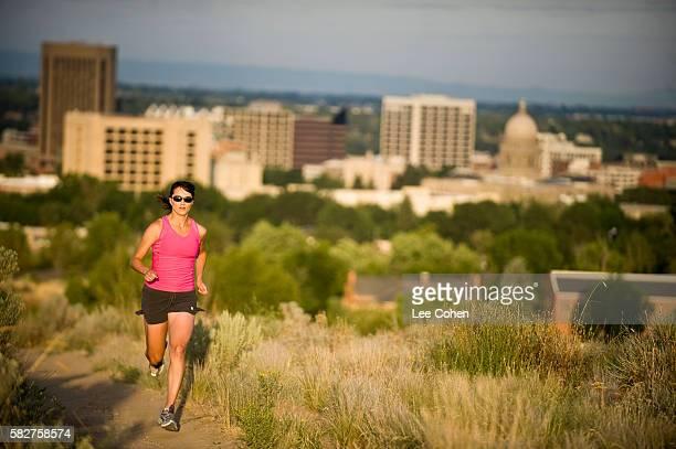 Woman running on trail in Boise, Idaho