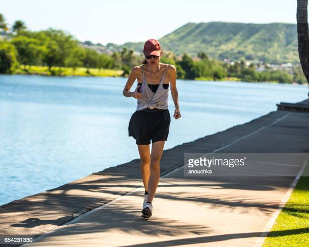Woman running outdoors, Hawaii, USA