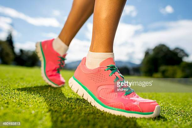 woman running outdoors - pink shoe stock pictures, royalty-free photos & images