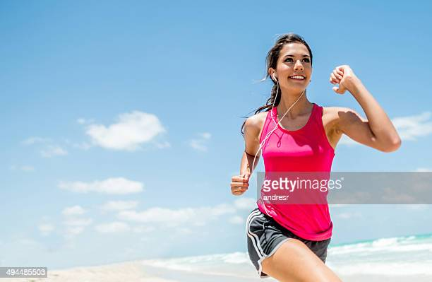 woman running outdoors - good condition stock pictures, royalty-free photos & images