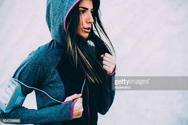 woman running - sports clothing stock pictures, royalty-free photos & images