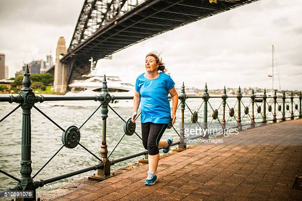 woman running - fat woman at beach stock pictures, royalty-free photos & images
