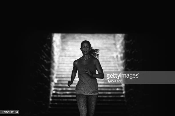woman running stairs - high contrast stock pictures, royalty-free photos & images