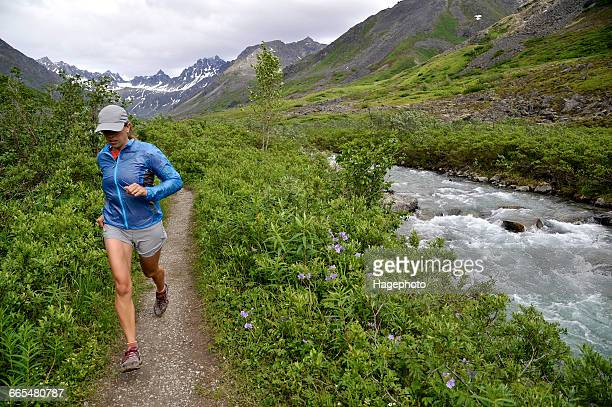 woman running the gold mint trail by little susitna river, talkeetna mountains near hatcher pass, alaska, usa - mt. susitna stock pictures, royalty-free photos & images