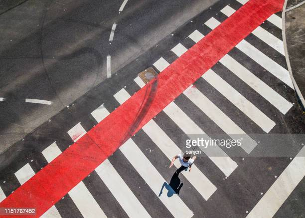 woman running through a zebra crossing - animated zebra stock pictures, royalty-free photos & images