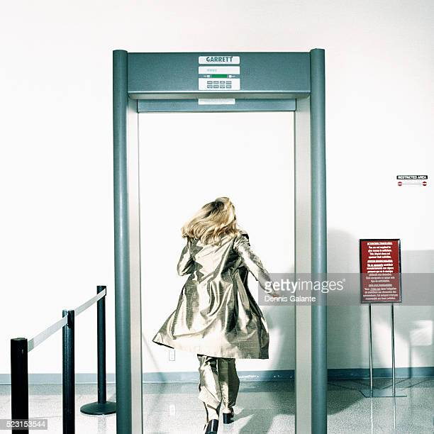 Woman Running Through Metal Detector