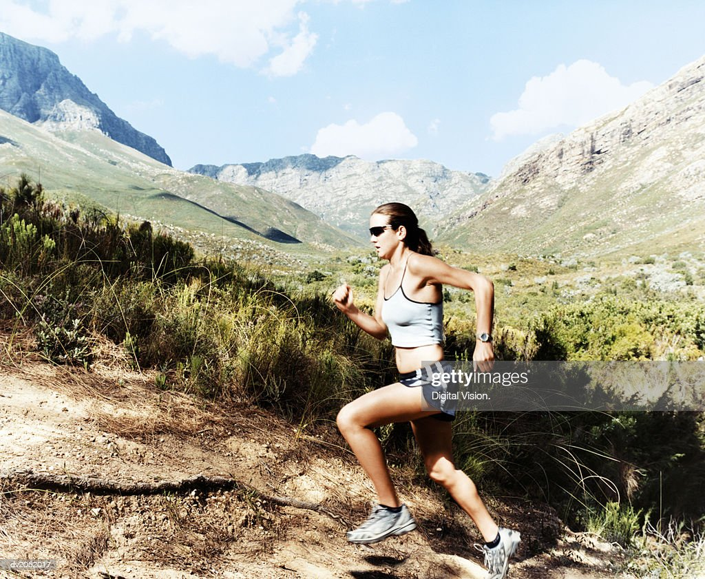 Woman Running Up a Hill : Stock Photo