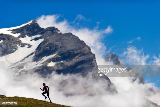 A Woman Running Up a Mountain.